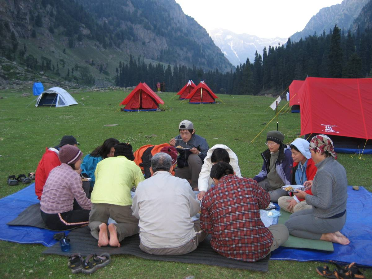 Group having meal on trek in Kashmir Himalayas